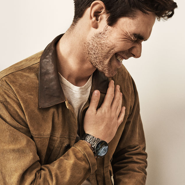 KJ Apa models new heart rate tracking Fossil Touchscreen Smartwatch the Q Explorist