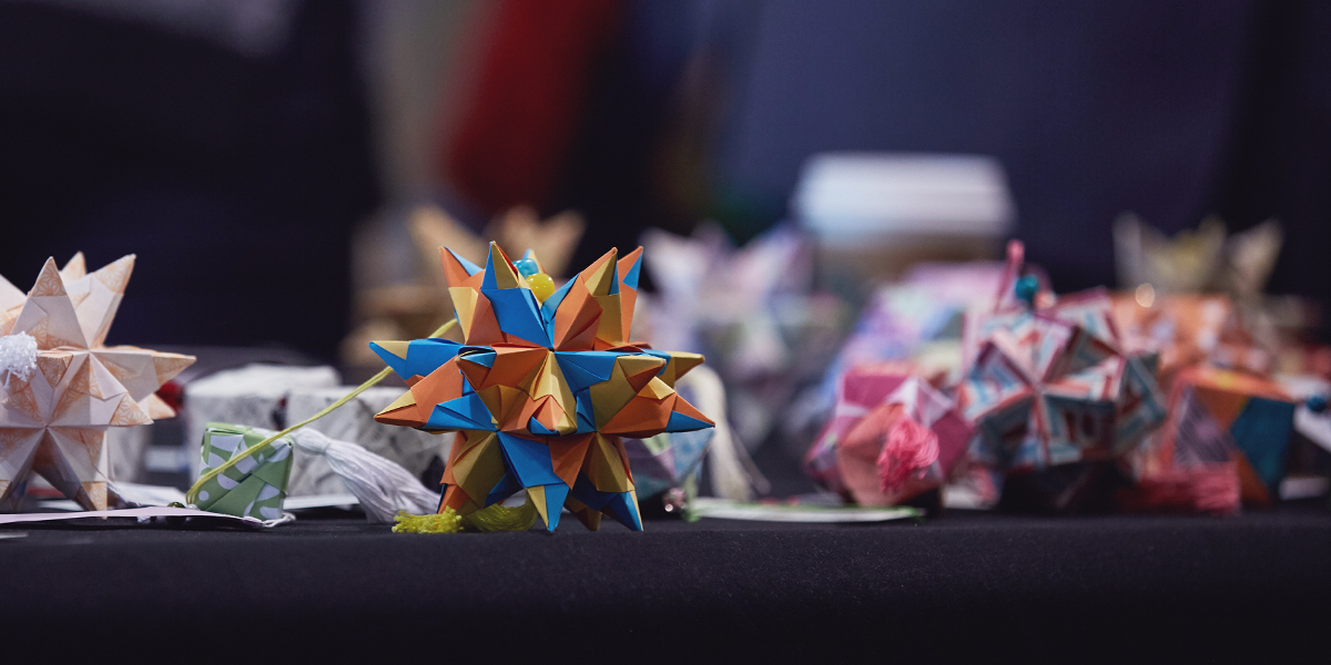 Fossil Group employees and their families had the opportunity to shop and fold origami for Paper For Water
