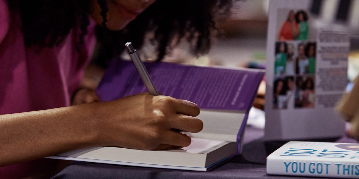 Maya Penn signs copies of her book, You Got This