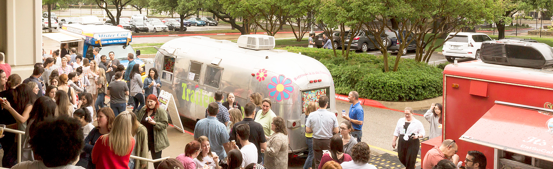 Fossil Group employees enjoy food trucks outside of Texas headquarters