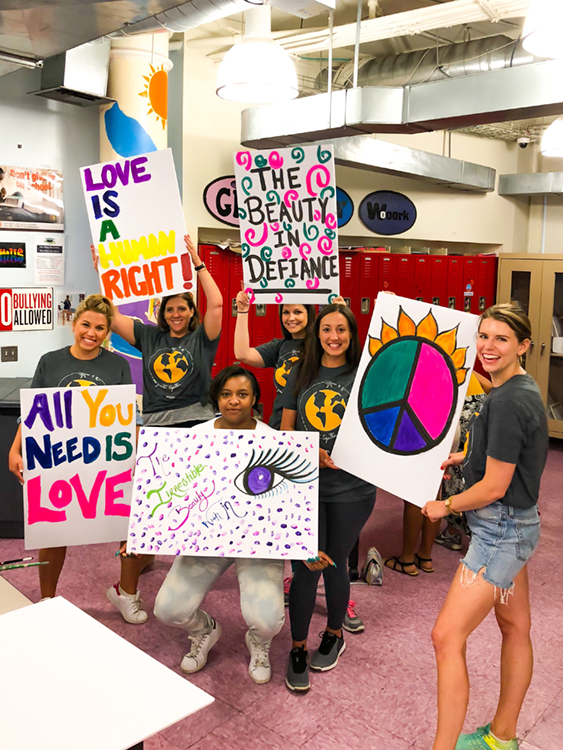 Fossil Group and Hetrick Martin employees make posters for NYC pride parade