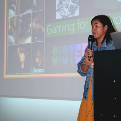 Andy Gonzalez shares her story of coding an original game at an IDG event at Fossil Group in Switzerland
