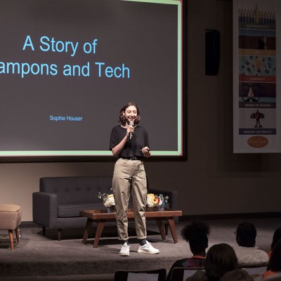 Sophie Houser shares her story of coding her original game Tampon Run with Fossil Group employees at IDG event in Texas