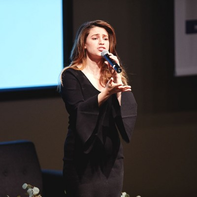 Aija Mayrock shares her original spoken poetry with Fossil Group employees at IDG event in Texas