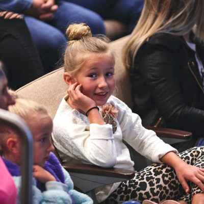 Fossil Group employees and their children watch keynote speeches at IDG event in Texas
