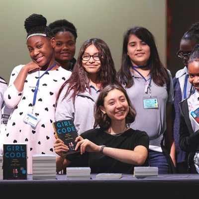 Sophie Houser poses with local students at IDG event in Texas
