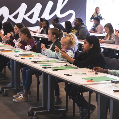 Fossil Group employees and their children attend a STEM workshop for IDG event