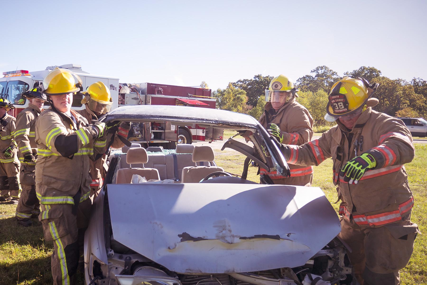 volunteer firefighters of Van Zandt county texas dismantle car during extraction training