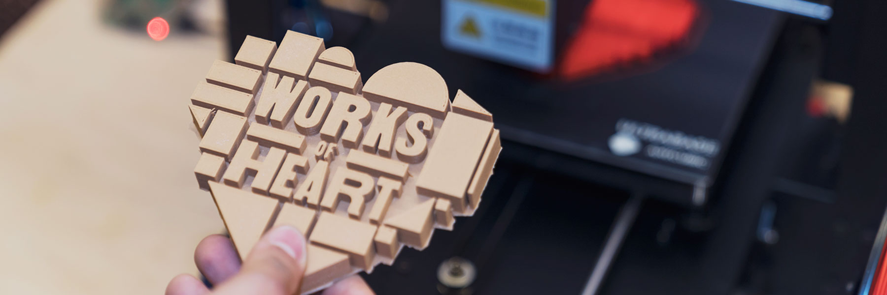 3-D printed Works of Heart logo