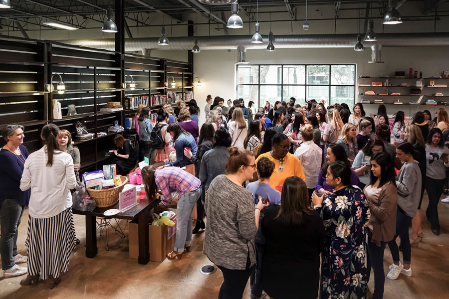 Fossil Group employees in Richardson Texas enjoy a happy hour on International Women's Day